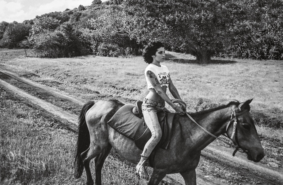 Amy Winehouse riding a horse